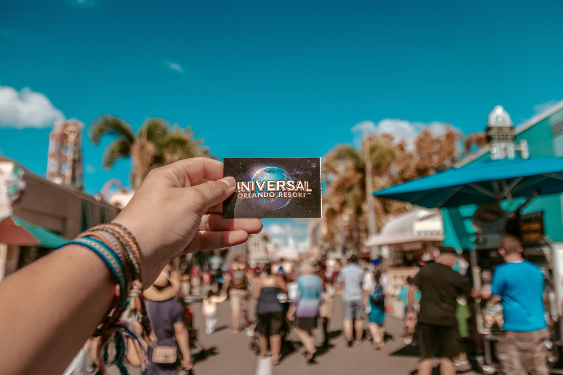 person holding universal studios ticket