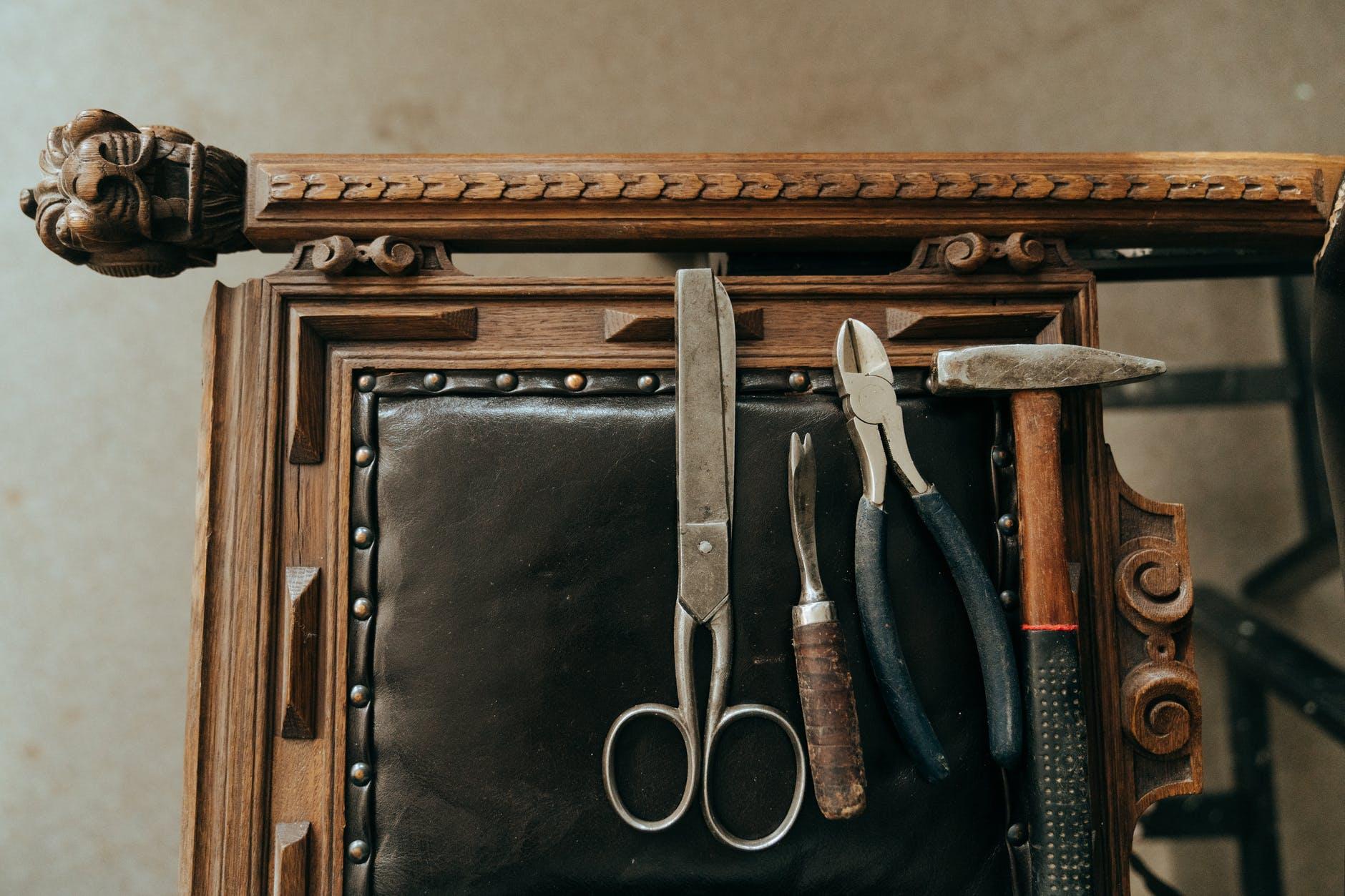 black handled scissors and scissors in brown wooden box