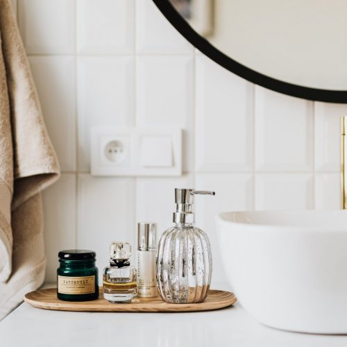 set of skin care products in contemporary bathroom