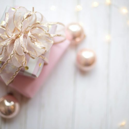 two pink and white gift boxes with ribbon